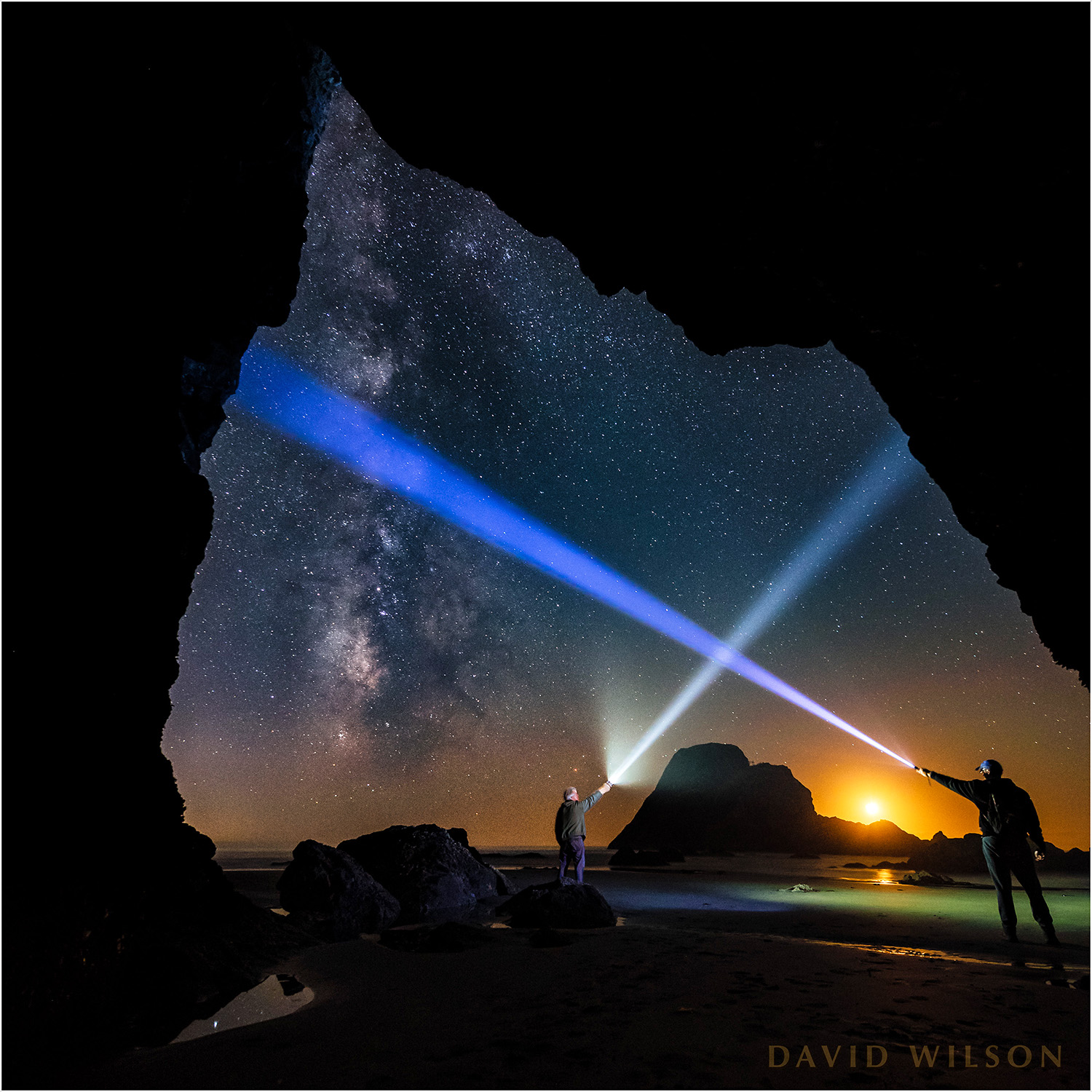 The Milky Way rises from the horizon near the glow of setting crescent moon outside of this hidden cave near Camel Rock, Humboldt County, California, while my brother and I play with our light beams. September 13, 2018.
