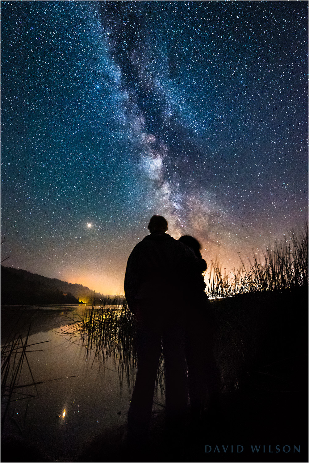 We stood on the still shore of Freshwater Lagoon and watched. Car lights sped by on US Highway 101. Mars hung quietly in the clear sky. The Milky Way rose before us like a great pillar, and a satellite slowly crawled up its length. September 2, 2018 in Humboldt County, California.