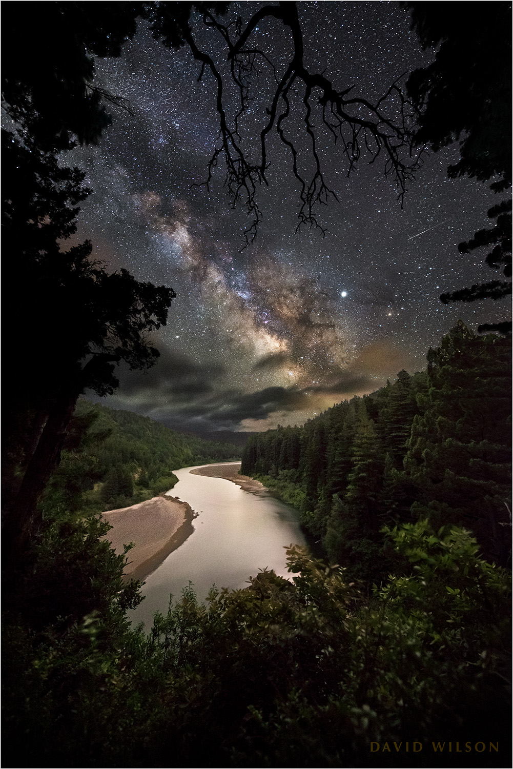 The Eel River glides between Redwood-covered hillsides under the night sky. I was there with a former student and her friend and we played with our cameras while we stood in awe of the night. There was even a shooting star, which I never saw until I examined the photographs later. Humboldt County, California.