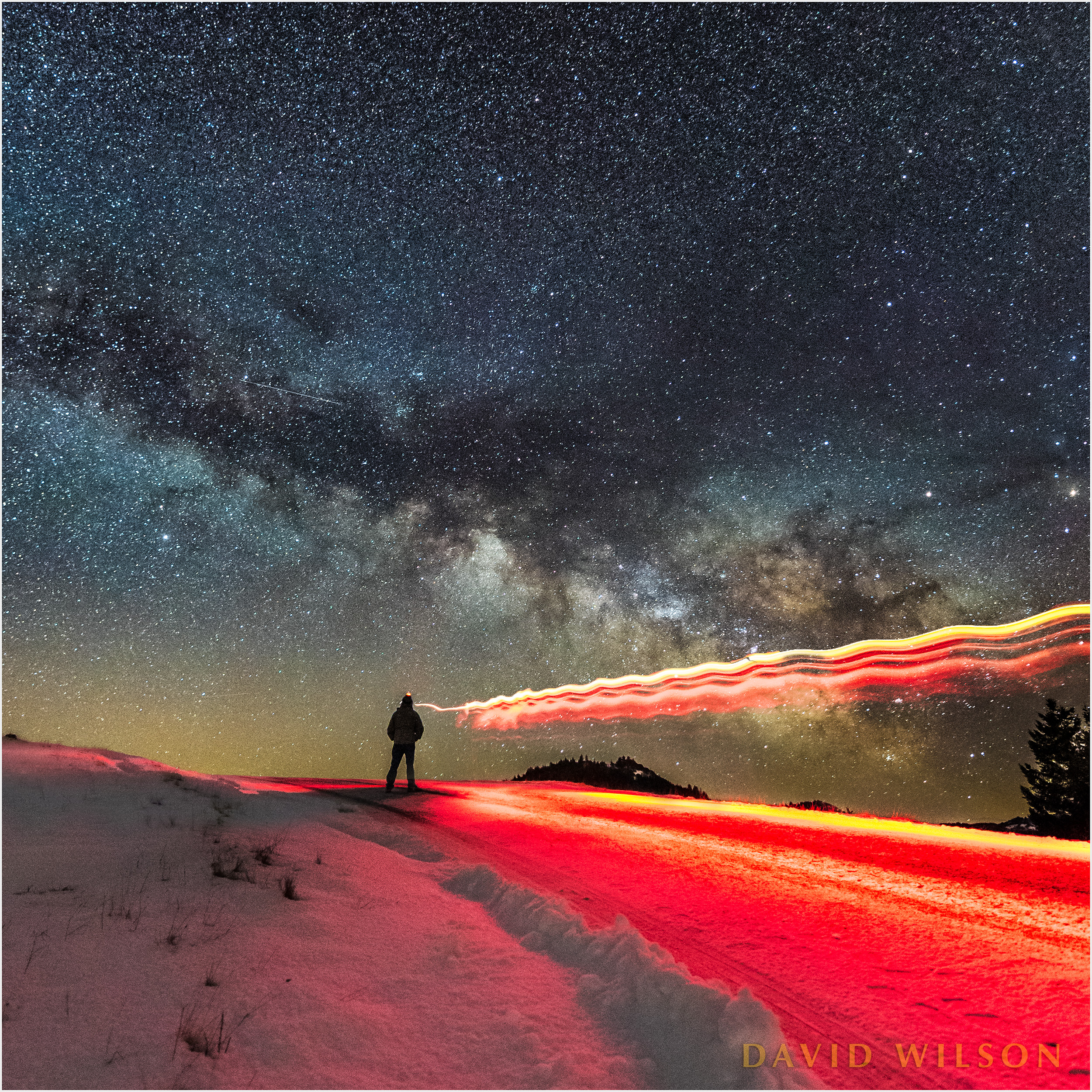 Light painted silhouette beneath Milky Way