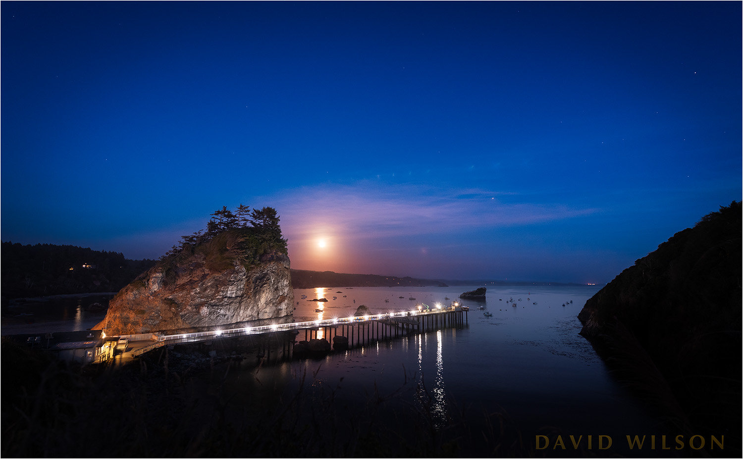 The full moon rises over Trinidad Harbor and Pier, August 2018.