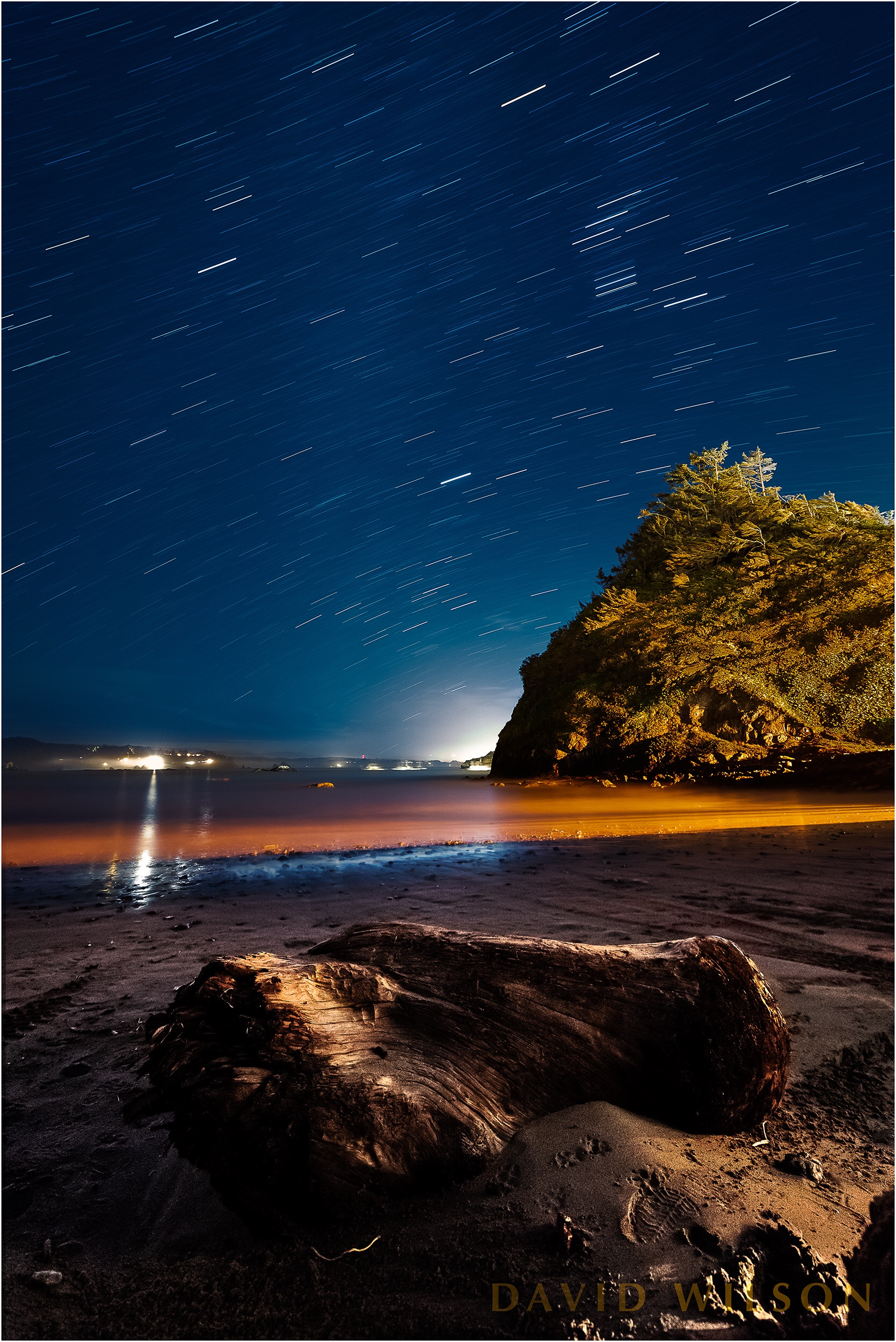 Boat Launch Beach at Trinidad, California beneath star trails in the night sky.