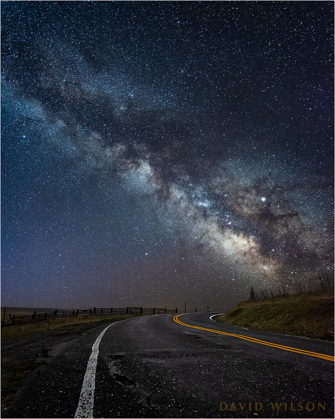 Rural road beneath Milky Way