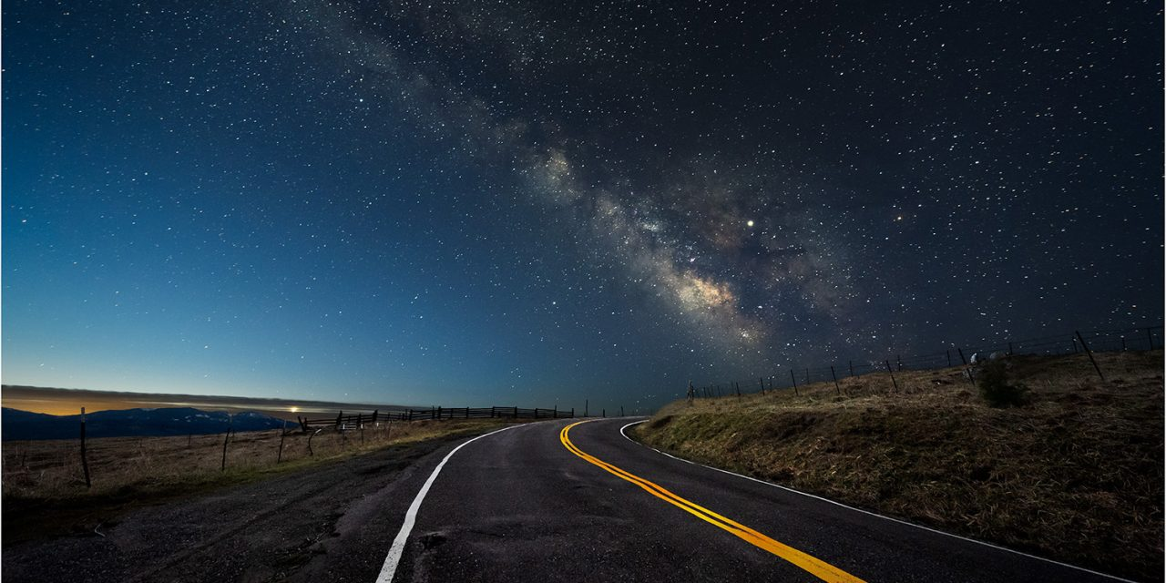 Dawn's glow brightens the horizon over the Kneeland Road as the Milky Way begins to fade.