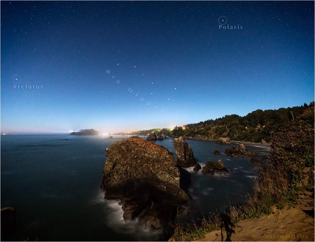 Trinidad, California glows beneath a starry sky.