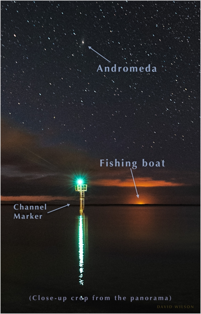 Closeup crop showing Andromeda and a distant fishing boat's glow.
