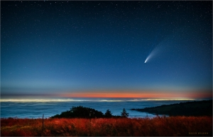 Fog filled expanse with Comet NEOWISE in the sky above