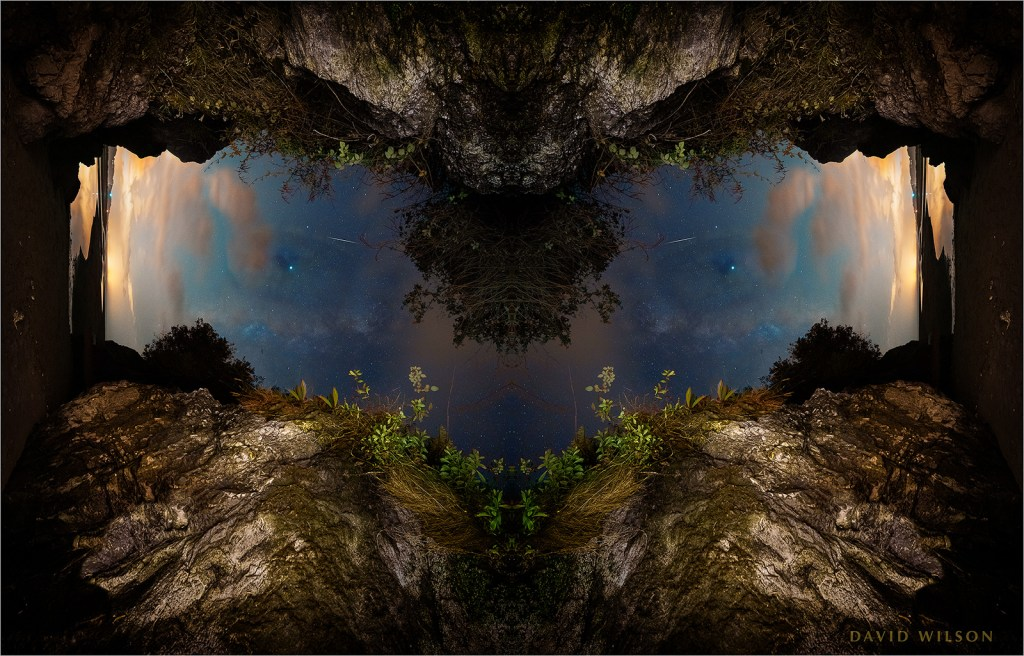One of a few plays on symmetry with a flipped cave entrance looking onto a nightscape