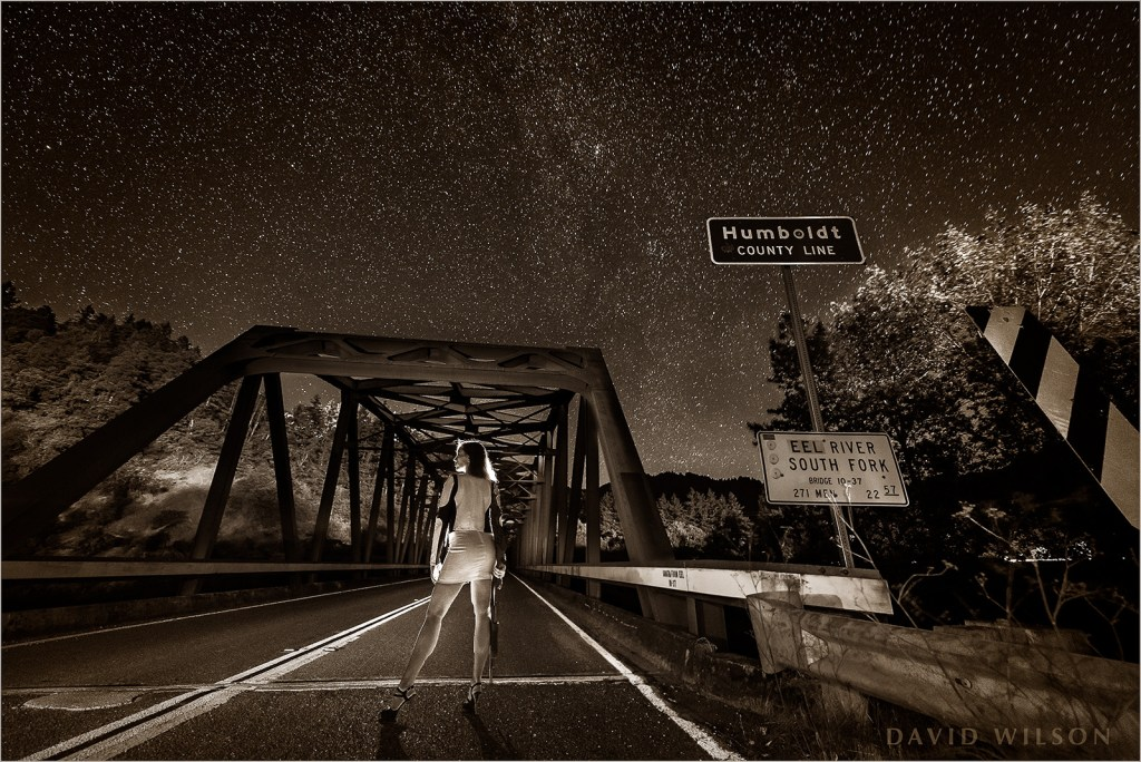 BW version: Woman with shotgun on the Cooks Valley Bridge at the Humboldt County Line