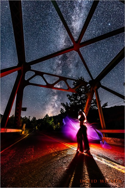 Dancer on the bridge beneath the Milky Way