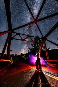 Dancer on the bridge beneath the Milky Way