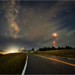 Total lunar eclipse sets over country road